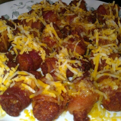 Bacon wrapped tator tots covered w cheese!