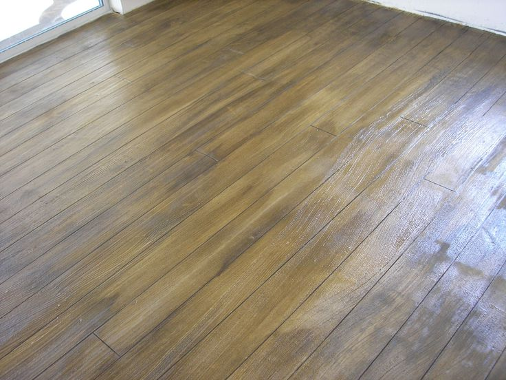 decorative concrete flooring made to look like a wood floor perfect