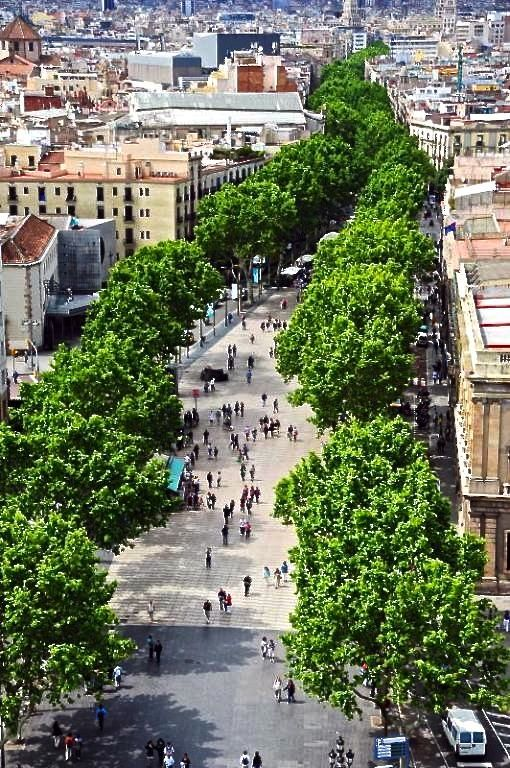 La Rambla: The most colorful street in #Barcelona, with open-air markets, historic cafes and people dressed as statues! Don't miss this walk, which ends at a beautiful pier.