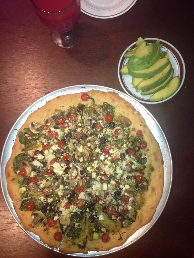 Greek Pizza Pesto, spinach, mushrooms, black olives, cherry tomatoes ...