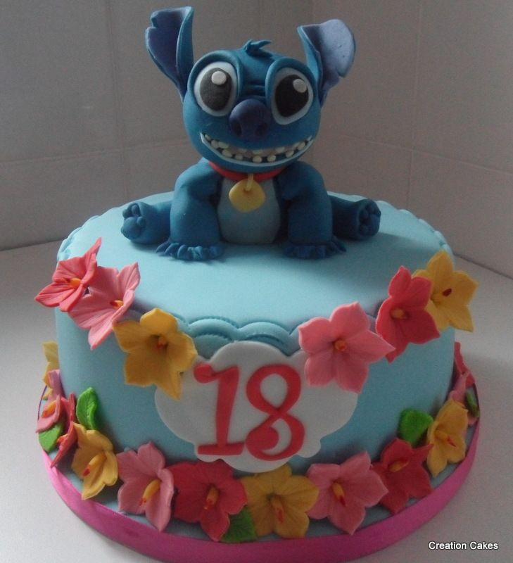 Stitch from Lilo and Stitch!  Hawaii themed cake, lots of colourful flowers to compliment him!  http://www.creationcakes.org.uk