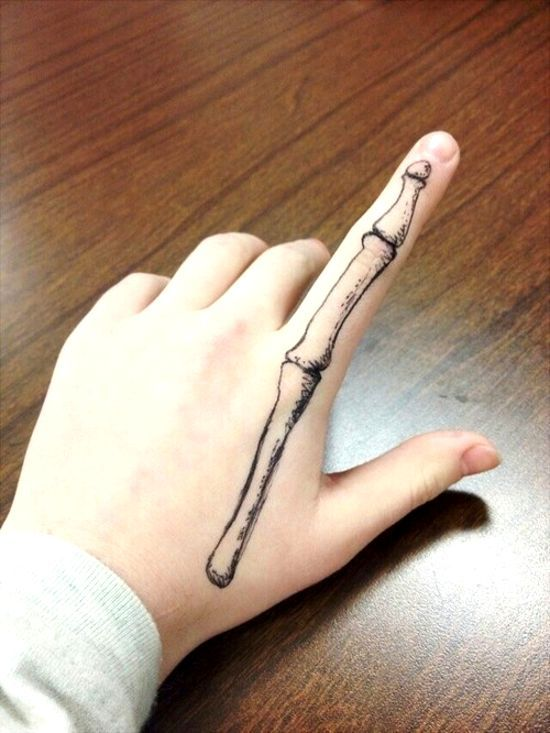 finger bone tattoo