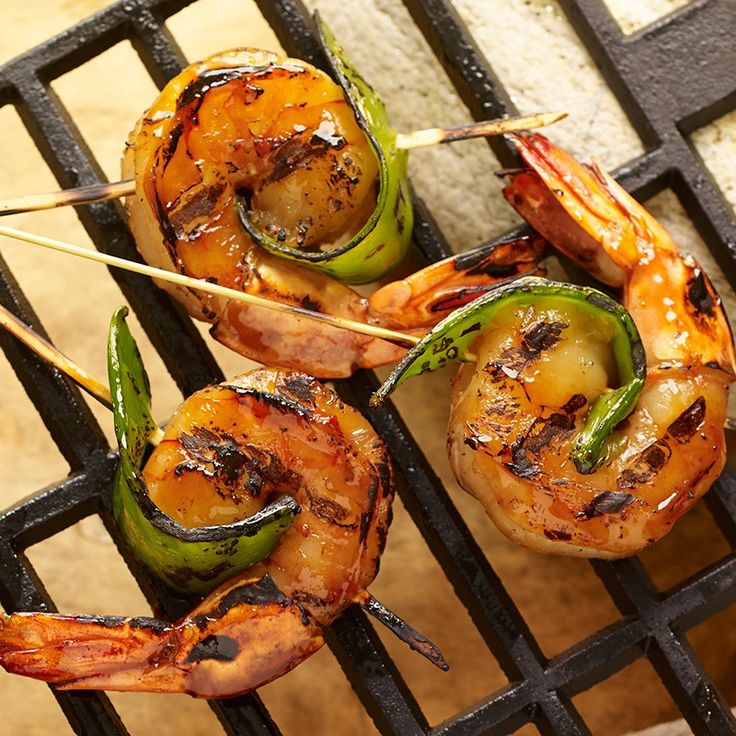 Skewer a snow pea pod around a sesame ginger-marinated shrimp for a ...