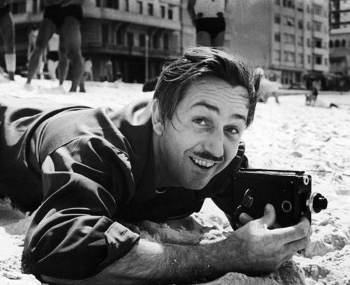Candid shot of Walt Disney with a camera