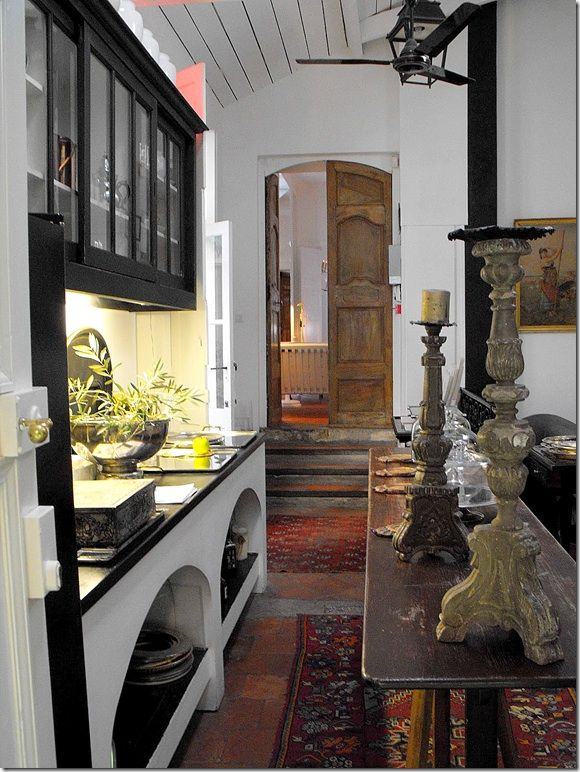 Old world kitchen with Turkish/Oriental rugs and nice architectural details