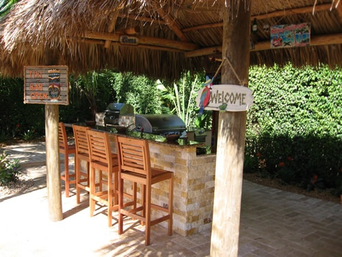 large tiki hut covering backyard kitchen backyard decor pinterest