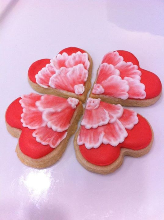 """Heart cookies with brush embroidered flower in a """"puzzle"""" style. ht..."""