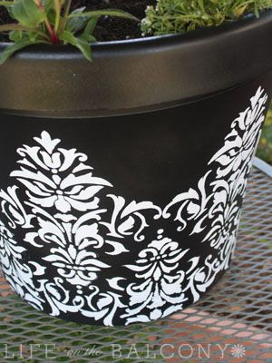 stenciling an ugly plastic pot = beautiful pot!