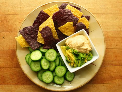 ... tortilla chips and cucumber slices with mashed avocado and hummus
