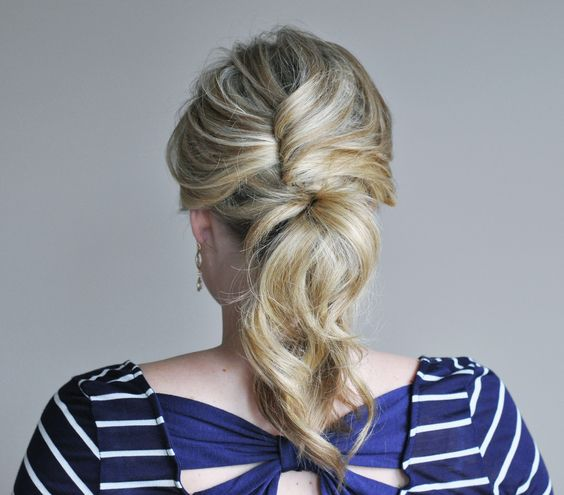 A simple cross-and-pin technique upgrades this cute ponytail. Get the easy steps here.