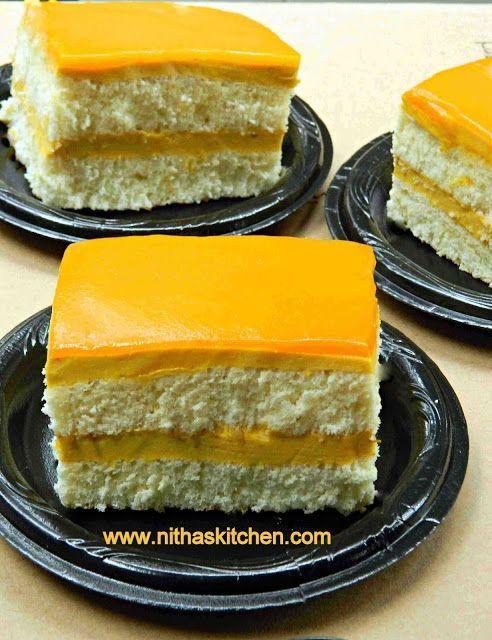 Layered Vanilla Cake with egg less Mango mousse filling and Mango ...