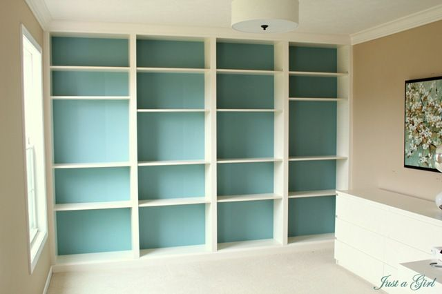 Billy bookcases from ikea, with the backs painted and trimmed out with molding...a great cheap solution....looks like a built-in