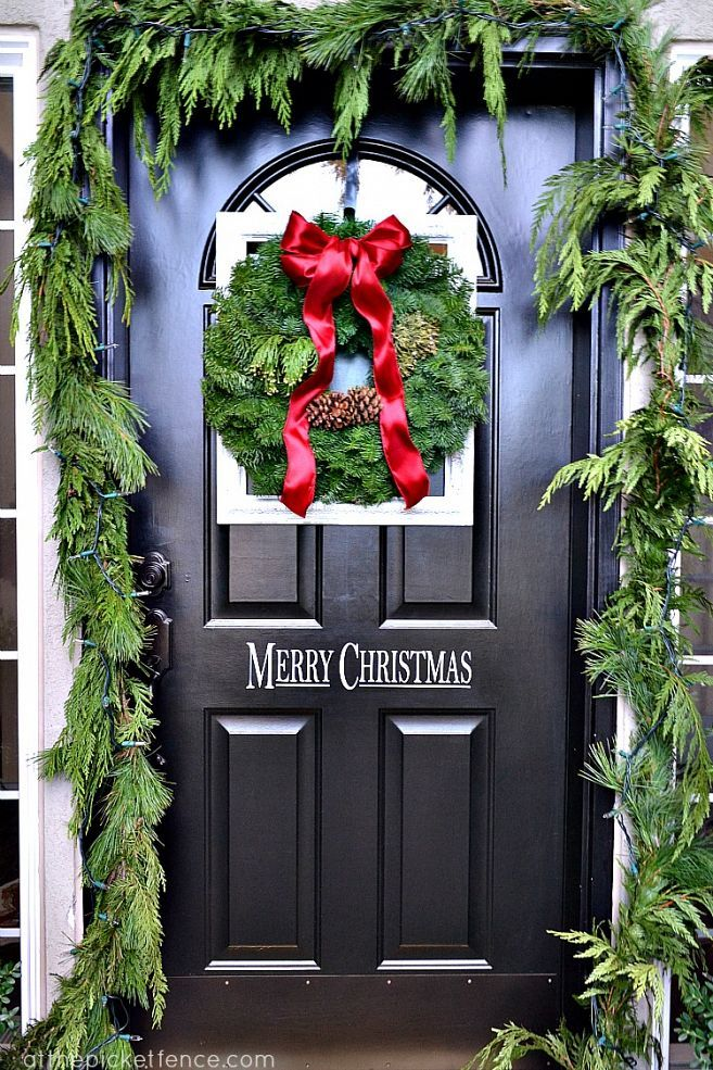 Framed christmas wreath on the front door and porch decor for Door garland christmas