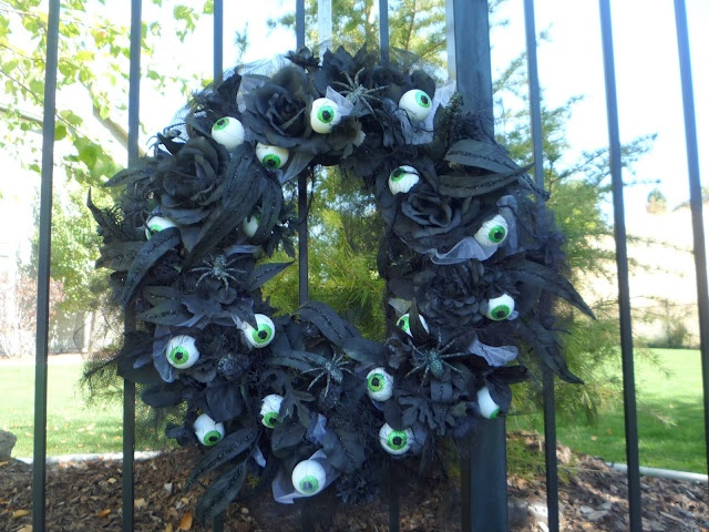 """halloween wreath. Easy--just spray paint old DI wreath black, and attach some """"googly eyes"""""""