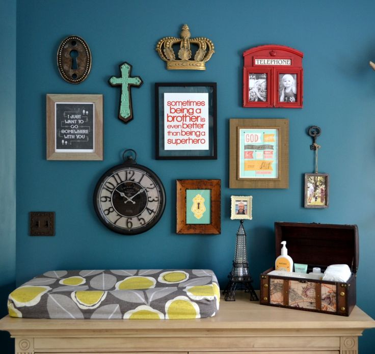 This eclectic, colorful gallery wall is the perfect touch to this #babyboy room!