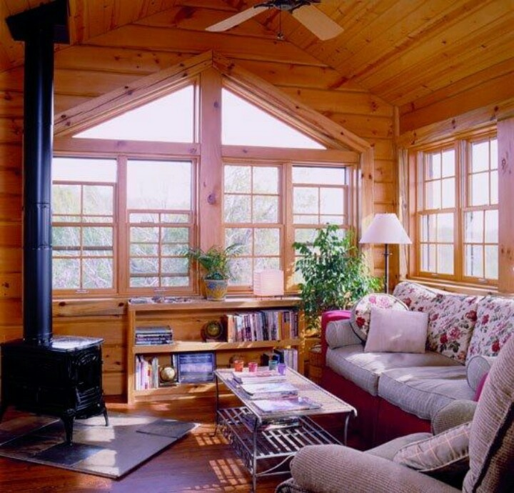 Stove sunroom cabin love pinterest for Log cabin sunrooms