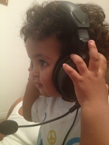 Kian on Xbox ear phones talking to his Uncle Michael.