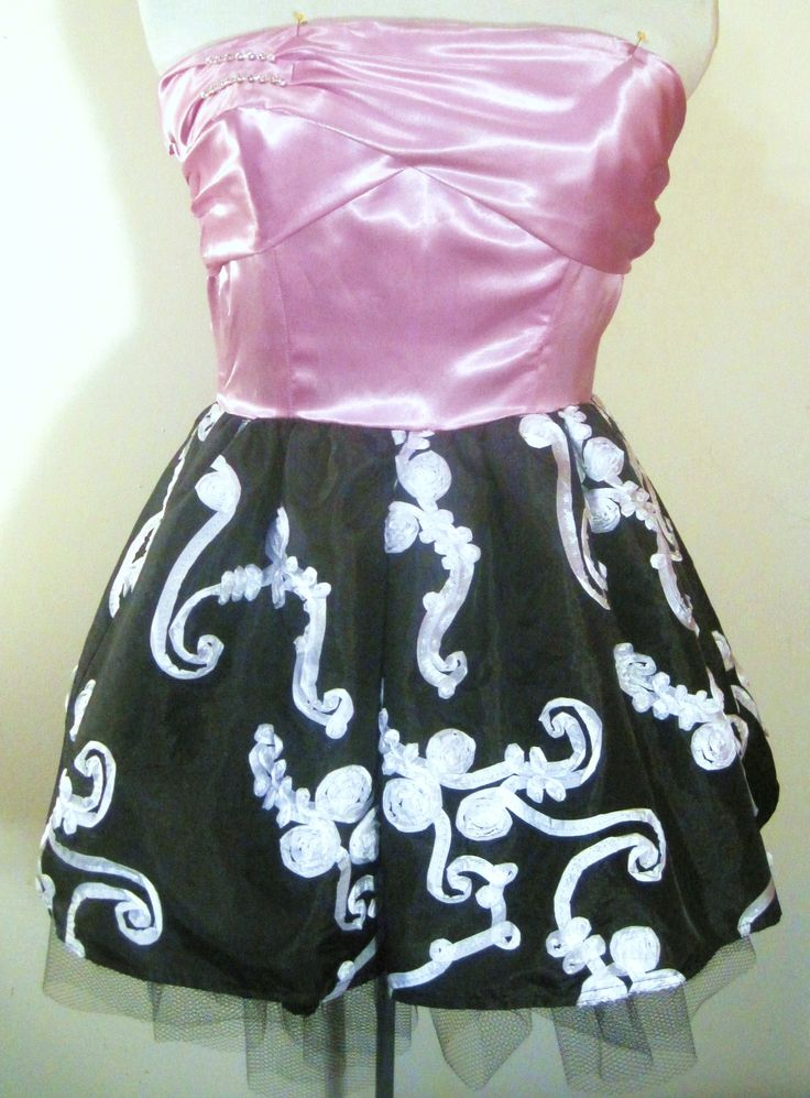 Lilac satin with draped bust and short skirt in black taffeta and ribbon rosette.  Has exposed crinoline and lining.
