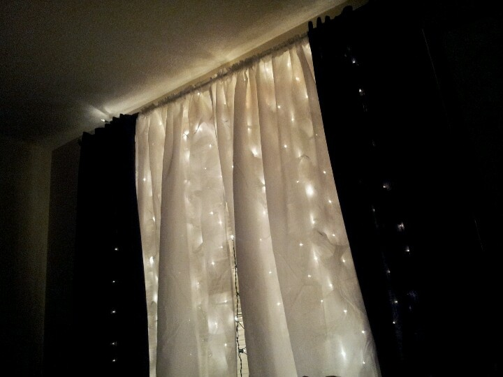 net lights on the curtain rod mounts, and put up sheer white curtains ...