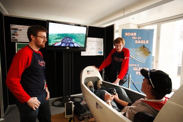 Soar like an eagle! Engineering students demonstrate a glider simulator, in Ingkarni Wardli.