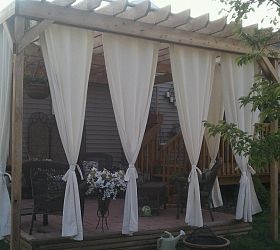 Sheer curtains on the pergola