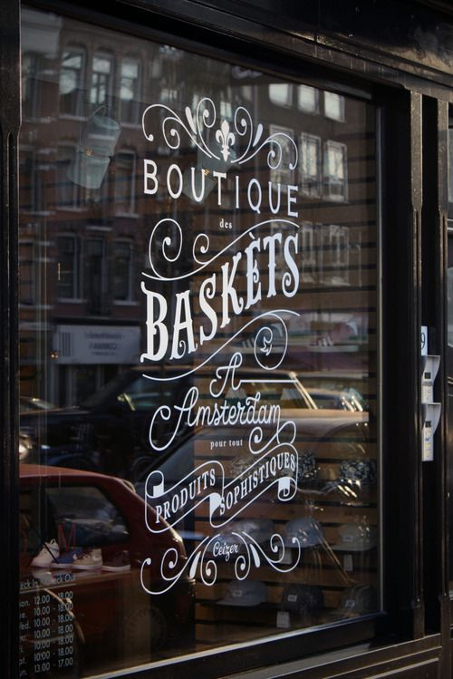 shop window in amsterdam - if we decide to go the lettering/ornament only route w/ no image, we could do something like this. If it still is too simple, it can be embellished even more w/ layered type, etc.