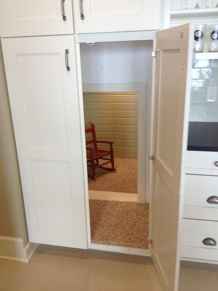 Secret room under stairs for kids hidden behind cupboards