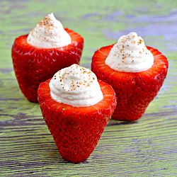 Ripe strawberries stuffed with no bake cheesecake and a touch of nutmeg.