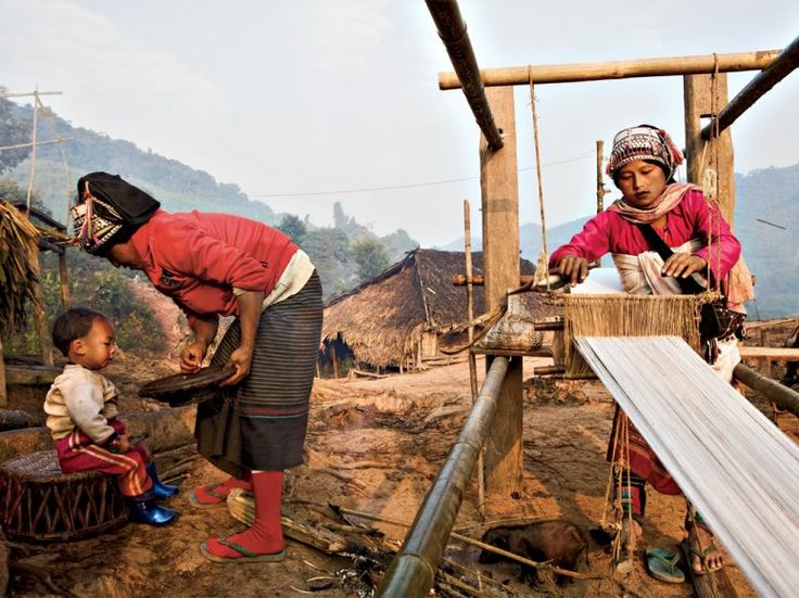 A Woman of the Akha Tribe Weaving Cotton on a Traditional Loom, Ban Nam Lai Village, Nam Ha National Protected Area, Laos, by Gideon Mendel
