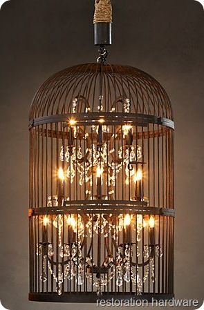 Restoration Hardware knock off DIY lamp. Old birdcage, chandelier type lamp, some rope and lamp gems, some bronze paint.