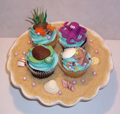 under the sea cupcakes  soooo have to make these for  someone! maybe for katelyn she is wanting me to make something for her.