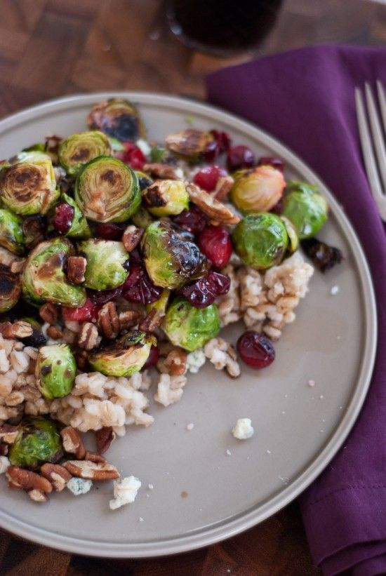 Roasted brussel sprouts, cranberries, gorgonzola, pecans, and balsamic vinegar.  Sounds so unbelievably good!