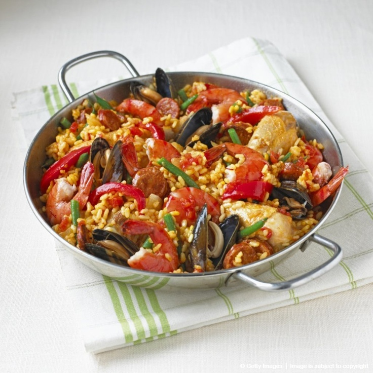 Chicken and seafood paella in pan