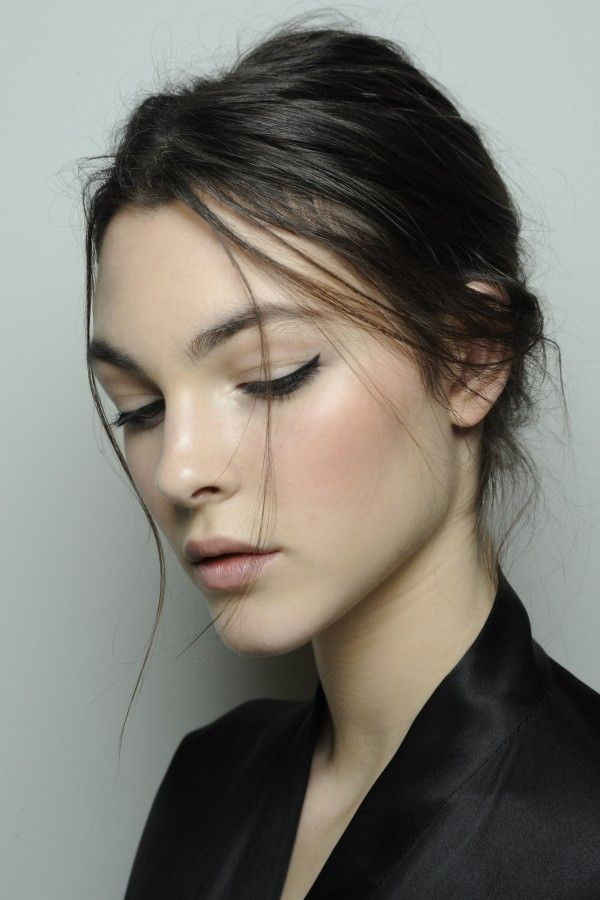Retro cat eye make up - black eyeliner with flushed cheeks and a loose easy updo - dolce-and-gabbana-makeup-fall-2014