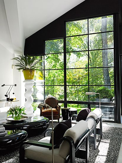 Incredible windowed wall in a Greenwich home by designer Patrick Mele. // #windows #home #greenery