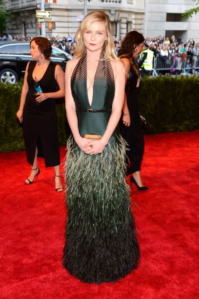Kirsten Dunst in feathered skirt Louis Vuitton at the Met Gala 2013