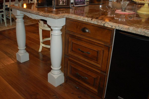 French country kitchen island with attached table