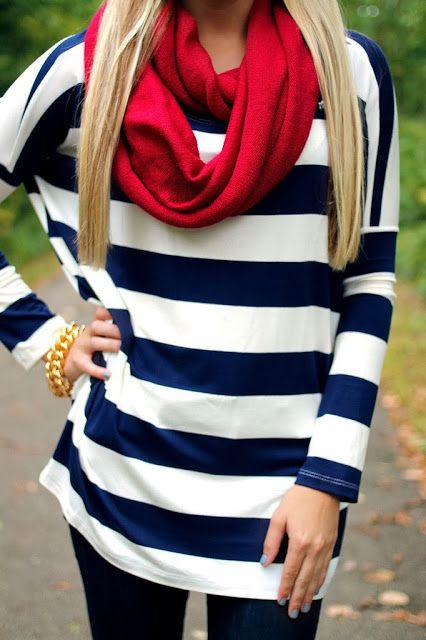 White and royal blue sweater with red muffler