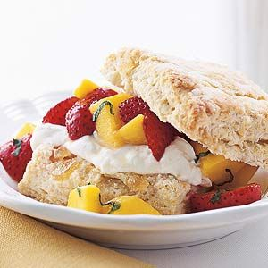 ... summer dessert is made with peaches and berries and topped with creme