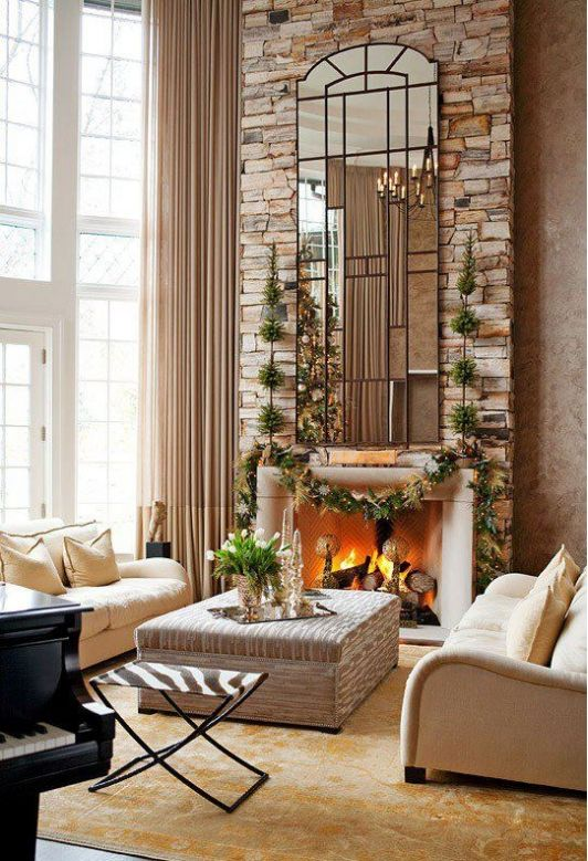 Beautiful fireplace with tall mirror above home and garden design