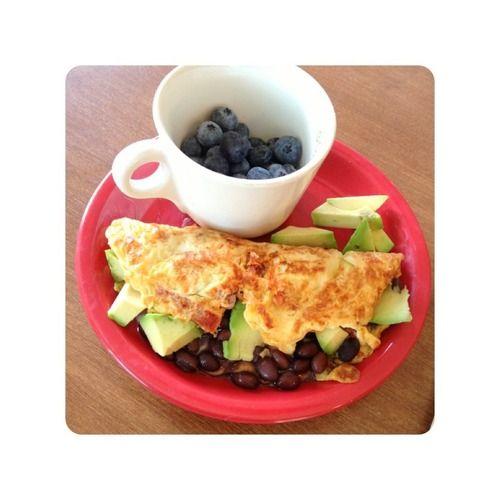 ... egg white omelette with tomatoes, black beans, avocado, mozzarella