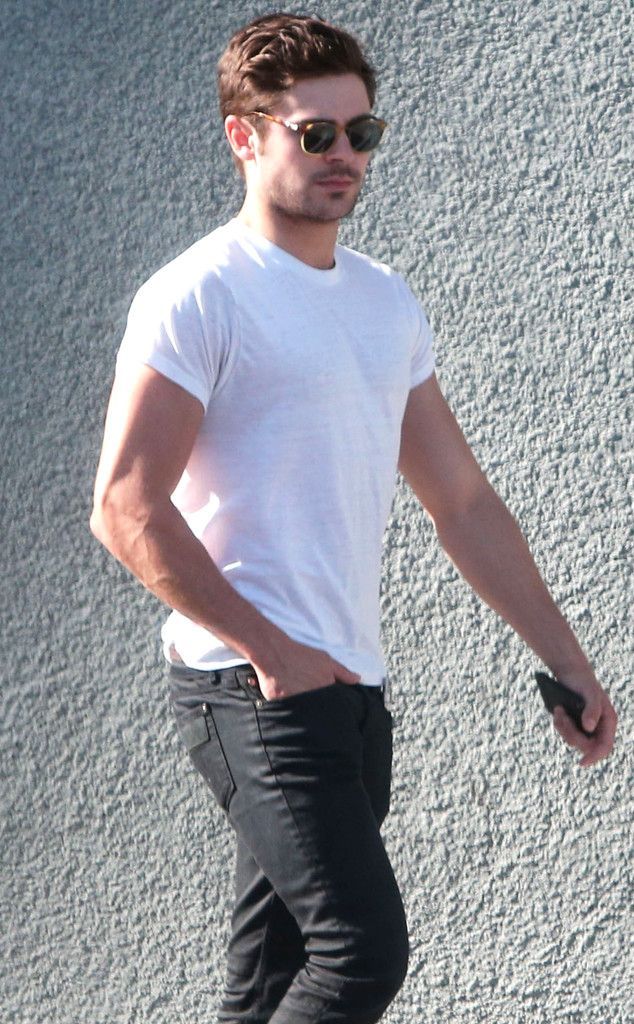 Zac Efron makes a simple ensemble, of black jeans, a white tee and Clubmaster-inspired sunnies, look oh-so-sexy!
