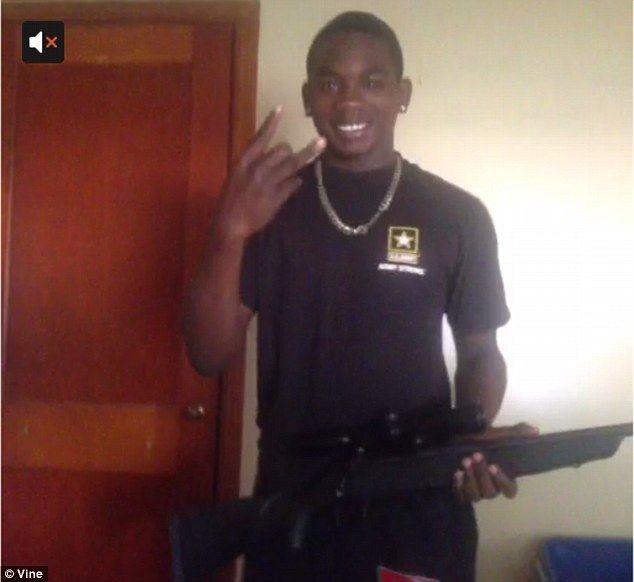 James edwards brandishing a shot gun and making a gang sign black on