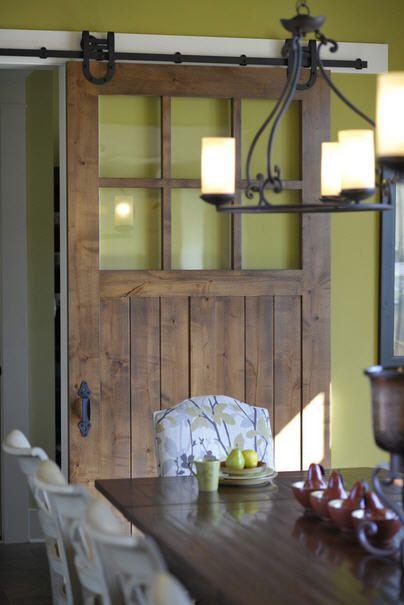 Rustic inspiration 11 sliding barn door designs for Barn door dining room