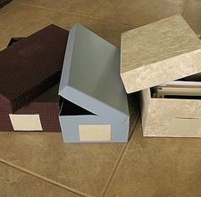 How to recycle shoeboxes into decorative storage containers.
