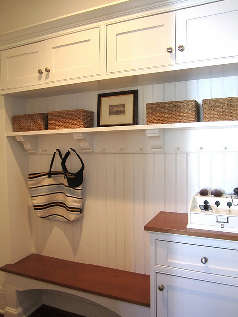 love the details in this entryway storage Perfect mix of seating, purse storage,