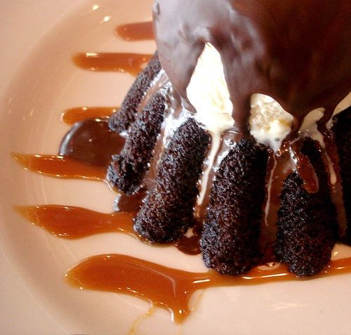 cream on a hot chocolate cake that's filled with hot chocolate molten ...