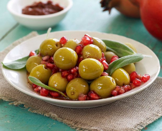 Spanish olives marinated in pomegranate, harissa paste and sage