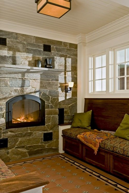 love the rock wall with small high fireplace for a smaller home not