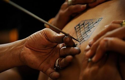 Cut bamboo cutting the skin tattoo. Painful!